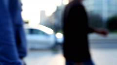Anonymous people walking in the street in a blurred and out of focus background Stock Footage