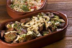 Sliced filet steak with mushrooms - stock photo