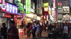 Popular city street in Shinjuku, Tokyo, Japan Stock Footage