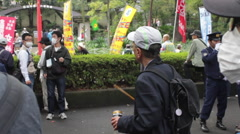 Anti-nuclear protester banging on a can in Hibiya Park. Tokyo, Japan - stock footage