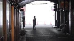 Women walking in silhouette under the subway in Tokyo, Japan Stock Footage