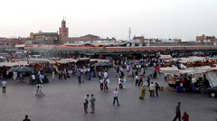 Morocco the market place in Marrakech at the Souk market overview Stock Footage