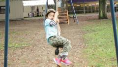 Young child on a playground zip line in Hibiya Park. Tokyo, Japan. Stock Footage