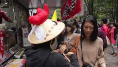 People getting free samples at a food truck in Tokyo, Japan Stock Footage