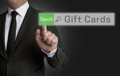 Gifts Cards browser is operated by businessman concept - stock photo