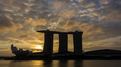 4K video time lapse : Singapore skyline at sunrise with 3 layer of moving cloud. Stock Footage