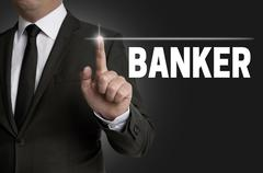 banker touchscreen is operated by businessman concept - stock photo