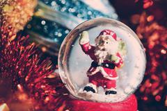 christmas snow globe and ornaments - stock photo
