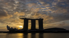 4K video time lapse : Singapore skyline at sunrise with 3 layer of moving cloud. - stock footage