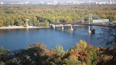 A beautiful autumn view of the pedestrian bridge over the river Dnipro Stock Footage