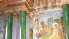 Church golden cross in focus against a background of icons of focus Stock Footage