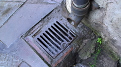Drain and pipe looped looking down Stock Footage