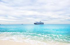 Cruise ship and tender on a light blue sea at Half Moon Cay in the Bahamas un - stock photo