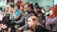 Models 4k  Photographers, videographers and viewers shoot the event on camera - stock footage
