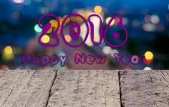 Happy New Year 2016 Text.With Wooden Desk And Abstract Blur Bokeh Background. Kuvituskuvat