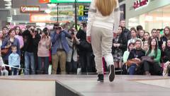 Models 4k Spectators watch as photographers take pictures of young model - stock footage