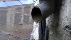 Drain pipe closeup Looped rain running Stock Footage