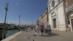 Tourists walking near Chiesa di Santa Maria della Visitazione in Venice Stock Footage