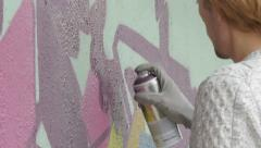 Guy with spray drawing urban graffiti on the wall, close up, street art. Stock Footage