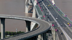 Cars driving on overpass and bridge across the Yangtze river Stock Footage