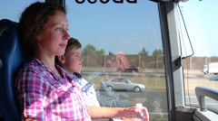 Happy boy with his mother going by bus at sunny day Stock Footage