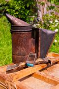 Old smoker on the wooden box. - stock photo