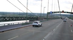 Many modern cars move on suspended bridge at summer day Stock Footage