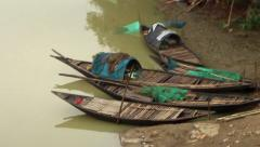 Boats by the side of a river in India side tracking shot slow motion Stock Footage
