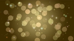 Golden bokeh lights, particles and starglow. Seamless Loop Stock Footage