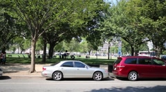 Cars are parking on street. City was founded in 1791 Stock Footage