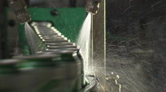 Cans of beer on conveyor belt being washed Stock Footage