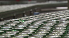 Hundreds of cans of beer on conveyor belt moving away Stock Footage