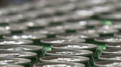 Dozens of cans of beer on conveyor belt moving (close up) Stock Footage