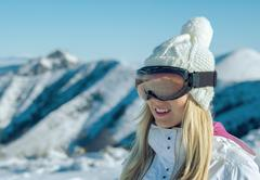 Female stay on the top of mountain with beautiful view - stock photo