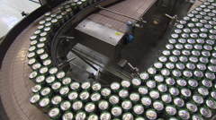 Hundreds of cans of beer on conveyor belt moving (high angle) Stock Footage