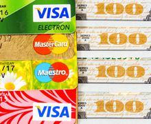 US dollar bills with credit cards Visa and MasterCard Stock Photos