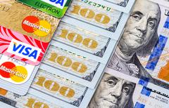 Mastercard Debit Card, Visa with US Dollar bills Stock Photos