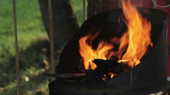 Forge fire in blacksmith's where iron tools are crafted Stock Footage