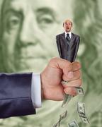 Hand squeezing businessma Stock Photos
