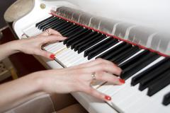 Playing the piano Stock Photos