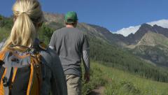 4k Couple and dog hike beautiful mountain trail in Colorado Stock Footage