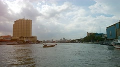 Cruising along the Chao Phraya River in Bangkok, Thailand Stock Footage