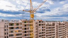 Construction site with workers  with yellow tower cranes, 4K time lapse Stock Footage