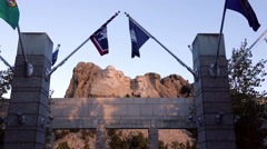 Mount Rushmore National Memorial with Flags Stock Footage