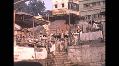 Vintage 16mm Film, 1970, India, Scindia Ghat, bathing in river #1 Stock Footage