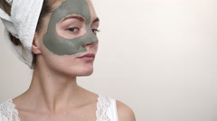 Woman with green clay mud mask on face 4K - stock footage