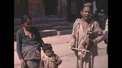 Vintage 16mm Film, 1970, Nepal, people music instrument singing - stock footage