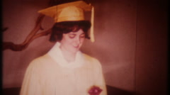 2761 - young female college graduate holds her diploma - vintage film home movie - stock footage