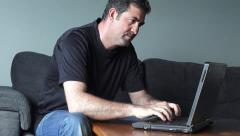 Man works from home on laptop Stock Footage