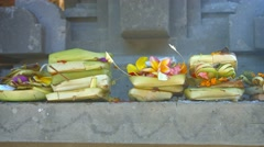 Offerings to Hindu Gods at Tirta Empul Temple in Bali, Indonesia Stock Footage